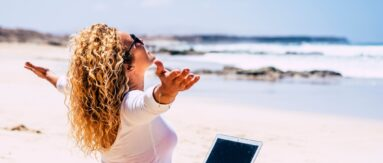 Digital nomad earning money working on the beach