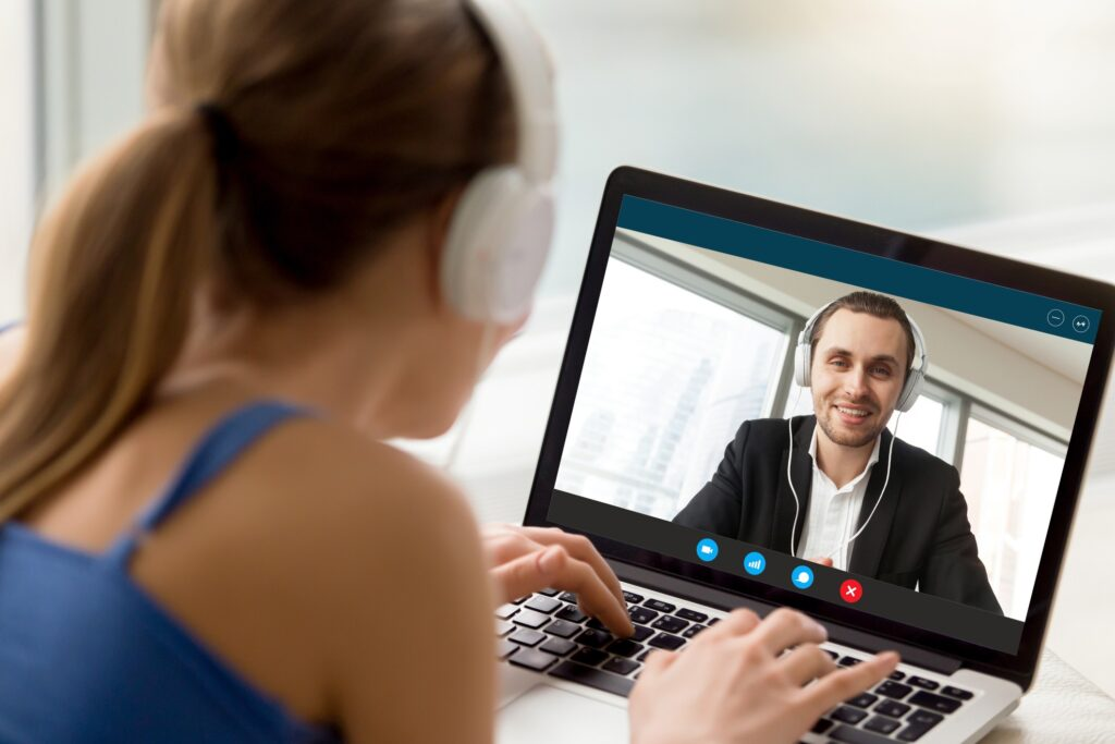 Remote worker communicating with client on laptop