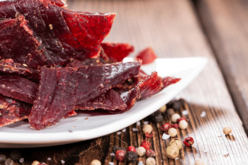 Although high in sodium, beef jerky packs a flavorful, protein-packed punch for remote workers.